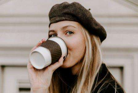 Woman drinking coffee for Amp Coffee and AmpCoffee.com